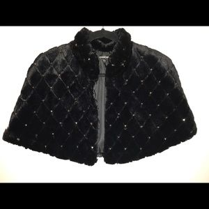 Black cape with quilted design and rhinestones.
